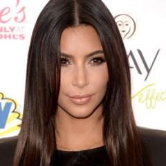 The Reason Kim Kardashian Hates To Smile