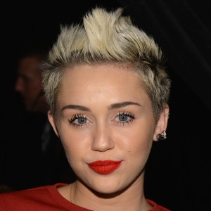 Miley Cyrus Reacts to Incriminating Photo